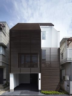 Built by Yo Yamagata Architects in Saitama-shi, Japan with date 0. Images by Forward stroke Inc. This house has plane configuration of three layers. Along a north-south from road side in that order the BUFFER, BODY...