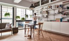 Taiwanese architects ST Studio renovated a cramped, two-bedroom apartment in Taipei and turned it into a flexible loft.