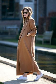 tort cat-eye sunglasses, long maxi camel coat, round watch and white Superga sneakers #style #fashion #fall #winter