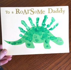 "Cut out a green dinosaur with construction paper, then paint your little one's hands to make the spikes! Add two googly eyes and write ""You are RoarSome Daddy"" What a great Father's Day keepsake! Credit to Becky Lee Make sure to follow Crafty Morning on Facebook, Pinterest, and Instagram or subscribe to our Weekly Newsletter! …"