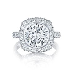 Tacori style no. HT 2614-2 RD 10. A round center diamond blooms in a cushion starlit crown and spotlight diamonds, bringing even more sparkle and light to the ring. With pave-set diamonds all along the band, this ring is worthy of being the symbol of your everlasting love and commitment.