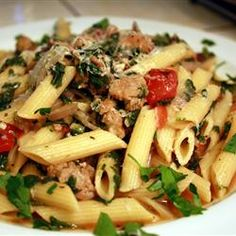 Pasta tossed in a simple sausage, tomato, and spinach sauce is a perfect weeknight meal. Modified from: Sausage Pasta Sausage Pasta Recipes, Italian Sausage Pasta, Pork Recipes, Cooking Recipes, Chicken Sausage, Turkey Sausage, Easy Recipes, Spicy Sausage, Garlic Chicken