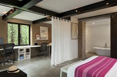Master bedroom with ergonomic home office and master bath