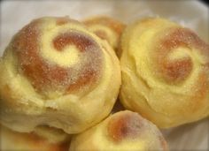 Ensaymada - Filipino Sweet Buns Ingredients: 2 tsp. instant yeast ⅔ cup water (lukewarm) 3 ½ cups of all purpose flour ⅓ cup of sugar ½ tsp. salt 3 large eggs ¼ cup evaporated milk ½ cup unsalted butter, melted (divided, 1/4 cup mixed in the dough and 1/4 cup for brushing) Topping: ½ cup of creamed unsalted butter ¼ – ½ cup of sugar *Optional – shredded cheddar cheese