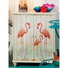 Storage Furniture, � two doorCabinet With Flamingo art for storing anything you want. Stack beach towels and beach items. Keeping things off the floor and neat.Dimensions: 2 x 25.6 x 12.6 � This is a oversized shipment additional shipping fees may apply.