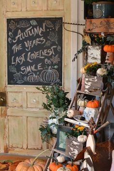 Chalkboard door and Fall on a ladder in the Potting Shed with mums, Indian corn and pumpkins | homeiswheretheboatis.net