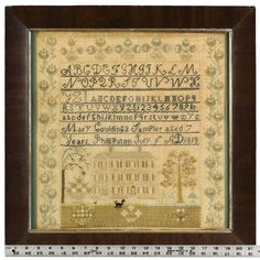 Antique House Sampler, by Mary Goulding, Massachusetts, with ruler for scale
