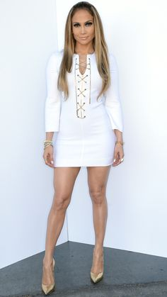 Jennifer Lopez's Head-to-Toe Looks From American Idol -MAY 1, 2014 Lopez was white hot in a chain front Michael Kors dress with gold Casadei pumps.