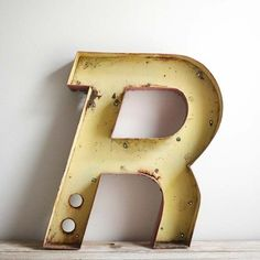the letter R  * i have one similar - only not italic...I would have loved at an italic.
