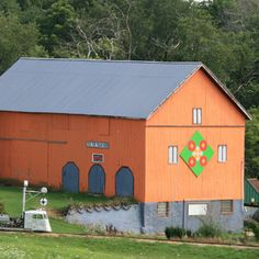 Orange Barn with a cool Quilt Pattern