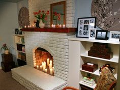 I would love to paint our fireplace white and fill it with candles, like this one on #DIYNetwork
