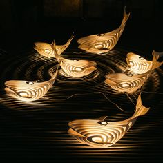 Designer Eduard Golikov has created an elegant wooden whale sculpture that doubles as an unconventional lighting solution. Crafted from birch wood, each piece is laser cut and assembled into a series of concentric shapes that form a sleek and stylized version of the beloved water-based creature. After its construction, Golikov coats the lamp in white paint and inserts an Edison bulb to cast a soft glow. The illuminated whale can be displayed a couple of ways. It can rest on a desk as a…