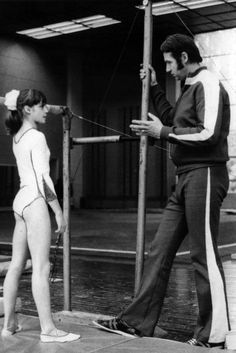 Nadia Comaneci ,Romanian 1976 Olympic Gold Medalist, first gymnast in history to receive the coveted perfect 10 and whose Famed coach, Bela Karolyi became a major figure in transforming American Women's Gymnastics.