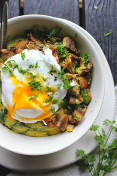poached egg over spinach polenta with crispy mushrooms herbs