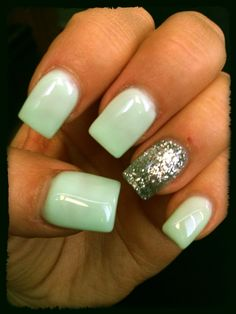 Mint nails with a silver glitter accent.