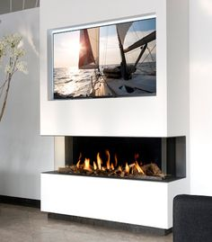 The View Bell Large has a very sleek design whats perfect for modern interiors. Log Burner Living Room, Living Room Decor Fireplace, Living Room Tv, Living Room Modern, Living Room Designs, Above Fireplace Ideas, Inset Fireplace, Fireplace Tv Wall, Fireplace Design
