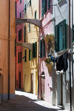 View of one of the many small streets in the ancient section of the Italian city of Ventimiglia.