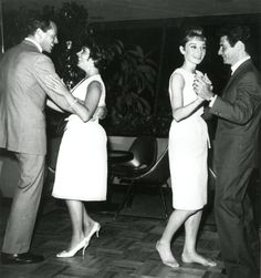 Audrey photographed dancing with Eddie Fisher. Audrey's husband Mel Ferrer can be seen dancing with Elizabeth Taylor.