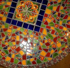 I want to do a custom mexican tile top on the kitchen table... we def. want a mexican flare in our house :)