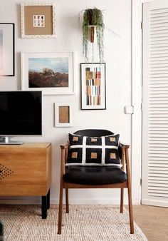 Add a plant to mix things up with your gallery wall-design addict mom
