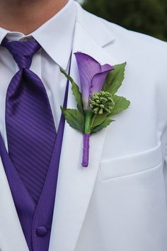 Purple wedding groom floral boutonniere