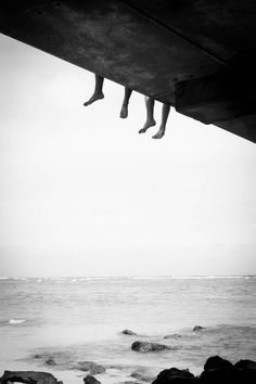 PERFECT SCENE | METAPHOR | FORESHADOW | POSTER ART - Two sets of feet hanging from a bridge. TAKE THE LEAP TOGETHER. JUMP INTO IT TOGETHER