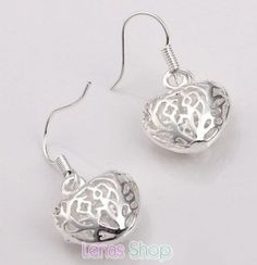 Boucles d'oreille coeurs pendantes, plaqué d'argent 925, motif filigrane en forme de coeur très fashion et pas cher.