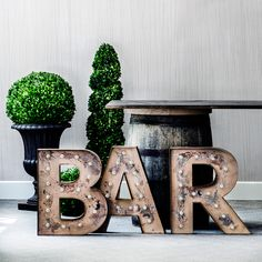 Cute idea to light up the bar for an outdoor get together. Also love these lite up with mr and mrs for engagement party or photos