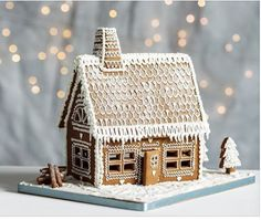 Hygge - making gingerbread houses at home. Light the candles and turn on the fairy lights. The smell of gingerbread around the house. White Gingerbread House, Gingerbread House Patterns, Cool Gingerbread Houses, Gingerbread Village, Gingerbread Cookies, Noel Christmas, Christmas Treats, Christmas Baking, Winter Christmas