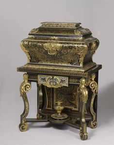 """Coffers, like this one made by Boulle, were used to store valuables. Ornamented with tortoiseshell and brass atop thin vineers, a technique coined """"boulle"""" that Andre Charles Boulle became famous for."""