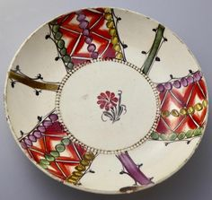 "RARE CREAMWARE SAUCER c1790 TARTAN HANDPAINTED STUNNING  Interesting tartan style handpainted decoration.   CONDITION - chip on edge of saucer, plus two very fine cracks on rim; only one of these shows on the front.  See photos.  DIMENSIONS  - diameter 4.75""; height 1"". £45.75"