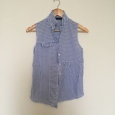 blue and white striped tank in good condition! really cute under sweaters or worn on it's own during the spring and summer! In good condition. Light weight Zara Tops Tank Tops
