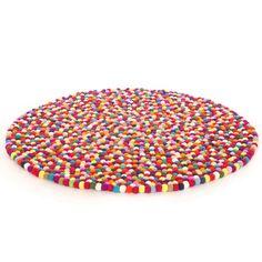 Colorful felt ball rug for a kids room <3