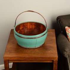 Own a piece of history with this beautifully kept vintage water bucket. Handcrafted from sturdy elm and reinforced with wrought iron, these buckets will decorate your home for years to come