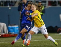 Carli Lloyd and Andressinha of Brazil, CenturyLink Field, Seattle, Oct. 21, 2015. (Otto Greule Jr./Getty Images)