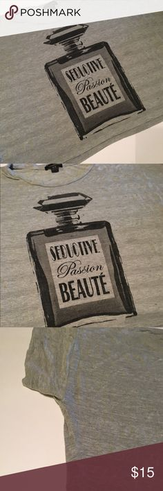 Gray Half off the shoulder shirt w Perf Bottle Md Gray Half shirt - off the shoulder Tshirt with Perfume Bottle picture.  Size Medium - but runs very large and very stretchy and loose. Very comfy. Trendy. Twentyone Tops Crop Tops