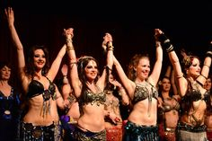 """Moria Chappell performing with The Bellydance Superstars on a """"Club Bellydance"""" tour.  Photographer: D Cognee"""
