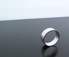 A simple Sterling Silver Band Ring, beautiful tutorial with lots of pics and explanations.