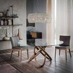 Okrągły szklany stół na podstawie z orzecha