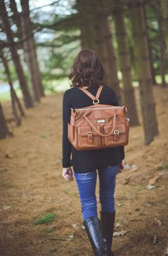 There's really not another bag out there like her! The Elizabeth from Lily Jade is a premium leather designer diaper bag that not only features over 16 pockets (!!) to keep you completely organized...it also converts into a backpack!!