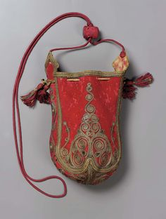 C19 drawstring bag. Red wool embroidered with gilt-silver yarns in conventionalized spiraling motif. Four peach drawstrings with red silk and gi...