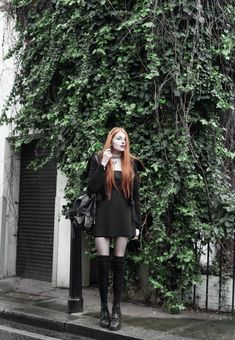 Olivia Emily wears Monki turle neck top, Asos A-line babydoll dress, Rogue And Wolf jewellery, Unif Dedi boots and Killstar Jane jacket