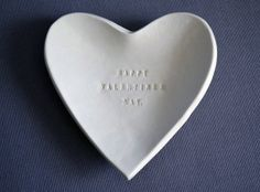 Valentines Day Gift - Happy Valentines Day - Heart Bowl - Gift Packaged $28.00. This sweet heart shaped ceramic bowl is completely handmade and stamped with Happy Valentines Day and would make a perfect Valentines Day gift! It's food safe or you can use it to hold wedding rings, keys or other special trinkets! #valentinesday #heartbowl #handmadegift