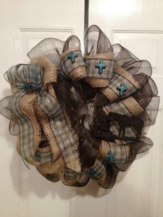Rustic turquoise, brown, and burlap mesh wreath with praying cowboy ornaments, by Jennifer Boyd Designs.    https://www.facebook.com/JenniferBoydDesigns