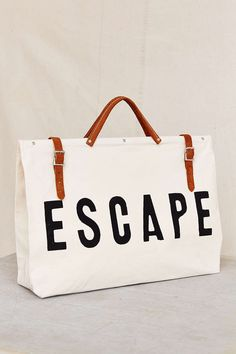 "perfect weekender for a road trip // white canvas ""escape"" bag"