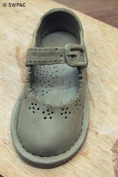 white clay baby shoe by Margot