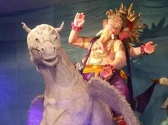 Vile Parlecha Peshwa made a 22-foot idol from 55,000 tissue papers, and seated atop a white mmm... dragon(?)