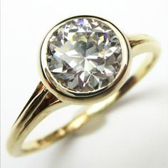 The Golden O:  An impressive 1.23ct antique diamond is elegantly displayed on a slender shank, with a silky bezel and just a touch of lacy filigree tucked under the stone. Ca.1940.  Maloys.com