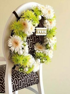 Dazzle dinner guests with wreath-festooned chairs. Place holiday-hue flowers in florist vials, and tuck the vials into a twig wreath base. Use wire to attach miniature ball ornaments. Tie the wreath to the chair back with crisscrossed lengths of ribbon. Straw Wreath, Twig Wreath, Elegant Centerpieces, Holiday Centerpieces, Chicken Wire Frame, Floral Chair, Wire Wreath Forms, Summer Wreath, How To Make Wreaths