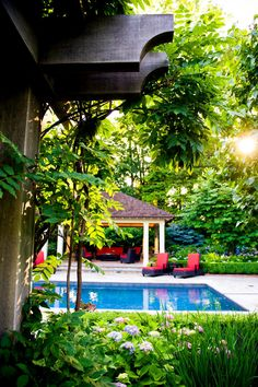 Private Pool With Red Cushioned Lounge Chairs
